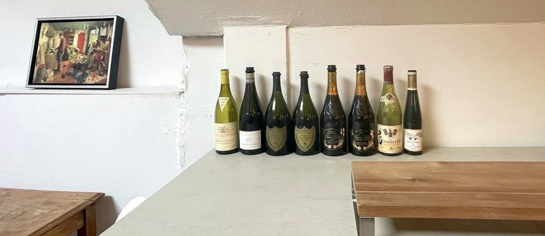 lege-wijnflessen-restaurant-avalon-wijn-spijs-davides